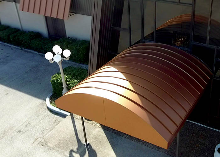 Flat roof wall panels in Burnished Slate and Awnings in Copper Penny